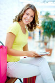 Shopper with touchpad — Stock Photo