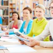 Learners in library — Stockfoto