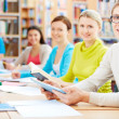 Stock Photo: Learners in library