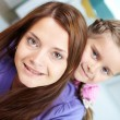 Female with daughter — Stock Photo #24197775
