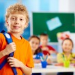 Schoolboy in school — Stock Photo