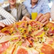Taking pizza — Stock Photo #24207013
