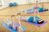 Exercising in gym — Stock Photo