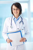 Clinician with documents — Stock Photo
