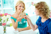 Friends and champagne — Stock Photo