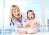 Pediatrician with baby — Stock Photo