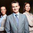 Business leader and employees — Stock Photo
