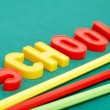 Pencils and letters — Stock Photo