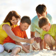 Family on sand — Stock Photo