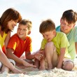 Stock Photo: Family on sand