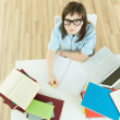 Student by the desk — Stock Photo
