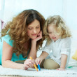Stock Photo: Drawing with daughter