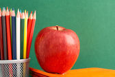 Apple and pencils — Stok fotoğraf