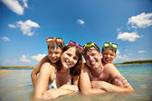Sunbathers in water — Stock Photo