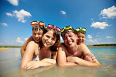 Sunbathers in water — Stock Photo
