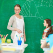 Teacher by blackboard — Stock Photo #28274165