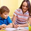 Schoolwork with mother — Stock Photo #28274505