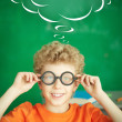 Stock Photo: Schoolboy in eyeglasses