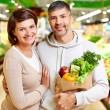 Stock Photo: Couple in supermarket
