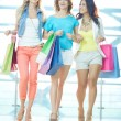Three shoppers in the mall — Stock Photo