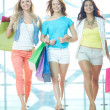 Stock Photo: Young shopaholics