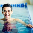 Guy in swimming pool — Stock Photo #28276695