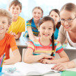 Pupils and teacher — Stock Photo