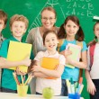 Teacher and learners — Stock Photo #28277895