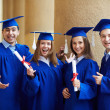 Stock Photo: Graduate friends