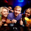 Friends in night club — Stock Photo