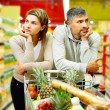 Couple in supermarket — Stock Photo #28279145