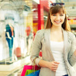 Shopper with credit card — Stock Photo