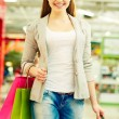 Stock Photo: Girl with purchases