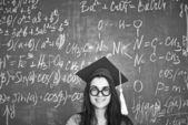 Girl in graduation hat — Stock Photo