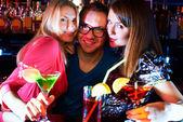 Girls and barman — Stock Photo