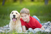 Lad and Labrador — Stock Photo
