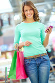 Girl with purchases — Stock Photo
