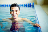 Guy in swimming pool — Stock Photo