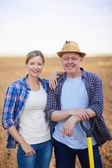 Male and female farmers — Stock Photo