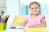 Girl with crayons — Stock Photo