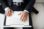 Businessman typing — Stock Photo