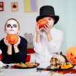 Twins with pumpkins — Stock Photo