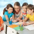 Teacher and pupils — Stock Photo