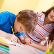 Schoolwork with mother — Stock Photo