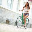 Stock Photo: Joyful bicyclist