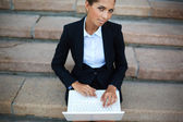 Businesswoman with laptop — Foto Stock