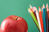 Colorful pencils and apple — Stock Photo