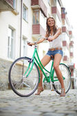 Girl on bicycle — 图库照片