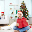 Lad with gift — Stock Photo