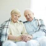 Seniors with tartan — Stock Photo